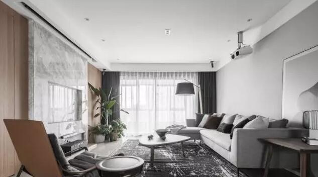 现代风格装修效果图,客厅大理石电视墙和投影很亮眼