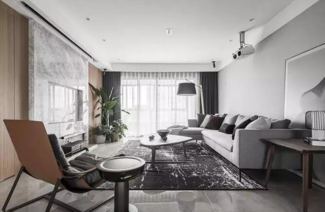 现代风格新房装修案例,客厅大理石电视墙搭配木饰面很亮眼